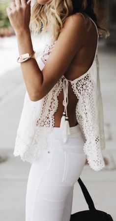 LOVE HER GORGEOUS & VERY FEMININE TOP, WHICH LOOKS FABULOUS WITH HER WHITE JEANS, GORGEOUS WATCH & TASSELS, HANGING FROM HER TOP!