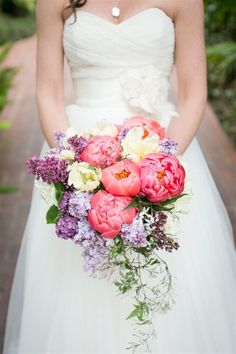 A cascading bouquet of peonies and lilacs