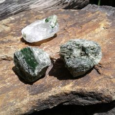 Chrome Diopside Crystals ~   Size ~ All 3 crystals are roughly 23mms   3 crystals total in this set, one of the crystals is Diopside with Ice Quartz, GORGEOUS   All pictures are taken in natural light  Link to our Etsy Shop is on our Pinterest Page