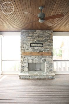 Screened in Porch with Beadboard Ceiling and Stone Fireplace