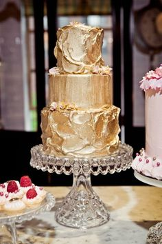 Love how the frosting is done in the yummy, homemade cake way, but then it is covered in gold.