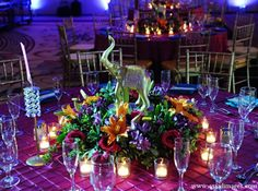 Stunning #floral #centerpieces at this brilliant #uplighting #wedding #reception! #diy #diywedding #weddingideas #weddinginspiration #ideas #inspiration #rentmywedding #celebration #weddingreception #party #weddingplanner #event #planning #dreamwedding by #asaadimages