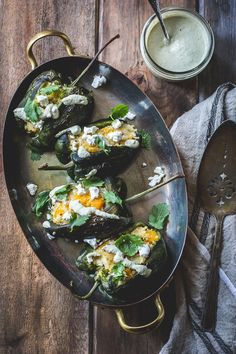 Roasted Poblano Chiles Stuffed with Cheesy Butternut Squash Quinoa + Pepita Crema from The Bojon Gourmet