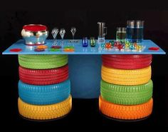 What a colorful way to repurpose old tires - www.highroadorganizers.com