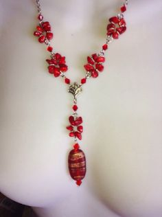 A personal favorite from my Etsy shop https://www.etsy.com/listing/220435326/vintage-look-chain-coral-necklace