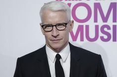 CNN anchor Anderson Cooper shared a picture of himself from the early 1990s without his signature silver hair.