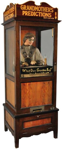 """""""Grandmother's Predictions"""" fortune telling machine, circa Originally made by William Gent Vending Company. Many reproductions of this style fortune teller have been available since the I like the two hardwoods used to add colour Vintage Carnival, Vintage Circus, Vintage Toys, Gypsy Fortune Teller, Penny Arcade, Ex Machina, Fortune Telling, Expo, Weird And Wonderful"""