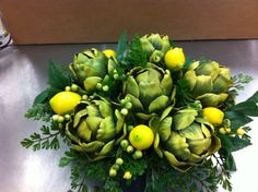 Artichokes and lemons  kitchen arrangement.