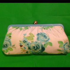 """Banana Republic blue silk floral clutch Beautiful 100 percent silk blue / white floral clutch.  Gold kiss closure at top with light blue leather trim.  Lining is light blue satan with one pocket for money and ID.  Measures 10"""" x 5"""".  Has a small starch on corner but not noticable. Price reflected. Banana Republic Bags Clutches & Wristlets"""