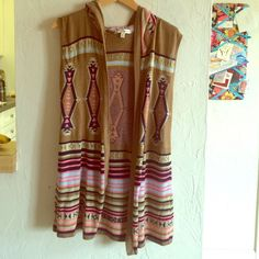 Tribal Tunic/Vest Very lightweight, and fun tribal tunic/vest. Can be worn over a cami, short sleeve or long sleeve shirt. Looks super cute over a bathing suit as well. Colors:brown, navy blue,taupe, baby blue, and coral. Jackets & Coats Vests