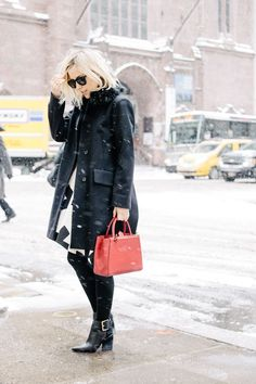 Jacey Duprie is wearing Sigerson Morrison boots, a black wool coat from Marni Shearling and a mini Fendi bag