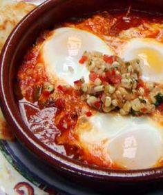 Three Guys From Miami show you how to make Huevos Enchilados, delicate poached eggs floating atop a pool of savory sofrito. Spanish Food, Spanish Recipes, Cuban Spanish, Spanish Paella, Spanish Dishes, Cuban Dishes, Cuban Cuisine, Good Food, Yummy Food