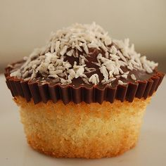 Please vote for me in this food photo competition. My dark chocolate topped coconut cupcake. YUMMY!