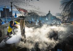 EuroMaidan; Kyiv, Ukraine 2013 - Protesters cook in a camp set up on Kyiv's Independence Square.