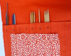 Quick needle case for knitting needles, made from a placemat.  IMG_2529 by craft room, via Flickr