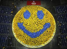 World's Largest Smile - 2,012 people wearing ponchos in Bangkok, Thailand.