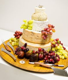 A wedding cake make of cheese! Delish! photos by Studio Impressions | via junebugweddings.com