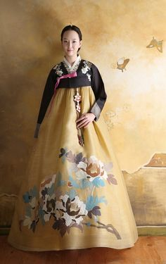 Hanbok skirts tie under the arms and are worn by the Korean culture. This skirt looks like the flowers may have been hand painted or have a hand painted look. Korean Traditional Clothes, Traditional Fashion, Traditional Dresses, Mega Fashion, Asian Fashion, Women's Fashion, Korean Dress, Korean Outfits, Costume Ethnique
