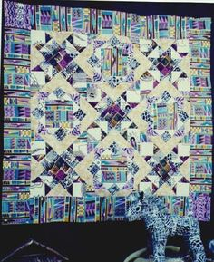 Trail of the Zebra – pattern.  The quilt features African fabric. There are nine blocks to this quilt. African and traditional fabrics  were used in the sample. Included with the quilt pattern is a pattern  for a small stuffed zebra. 46x46 finished size. $8.50