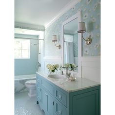 This bathroom features custom designed vanity in blue (Benjamin Moore Buxton Blue) with glass knobs, bubble tile accent wall and floor and wallpaper above wainscot. Bathroom Renos, Bathroom Interior, Small Bathroom, White Bathroom, Bathroom Ideas, Small Tub, Bathroom Vanities, Bathroom Designs, Coastal Bathrooms