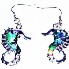 Seahorse Earrings in Abalone and Sterling Silver Handmade Jewelry by NorthCoastCottage Jewelry Design & Vintage. Let these beautiful seahorses of abalone and sterling silver grace your ears this summer, also great go-to earrings all year long. Marvelously detailed, shimmering with