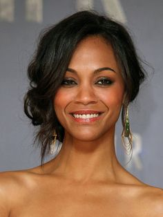 Zoe Saldana's graceful updo looks very feminine with looped waves and piece-y bits wandering through.