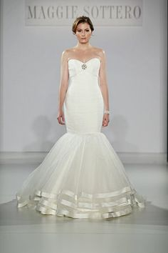 Maggie Sottero Spring 2013 Runway--I like the bottom of this dress. I hate the thing between the bust.