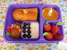 French bento lunch for Bastille Day. Goodbyn lunchbox, alphabet picks, leaf picks, dog pick and silicone wrap band all from www.thelunchboxqueen.co.nz