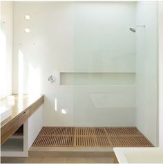Slatted wooden shower floor along with wooden tub. Clean lines. Use shower fixtures already owned.