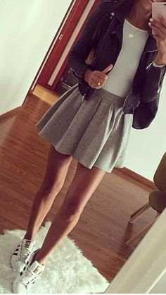#spring #outfits woman in black leather jacket and grey mini skirt standing in front of mirror taking picture. Pic by @fashiondemands
