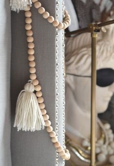 natural wooden beads. love this idea for tie-backs and its combination with grey.