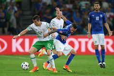 Stephen Ward of Republic of Ireland and Federico Bernardeschi of Italy compete for the ball during the UEFA EURO 2016 Group E match between Italy and Republic of Ireland at Stade Pierre-Mauroy on June 22, 2016 in Lille, France.