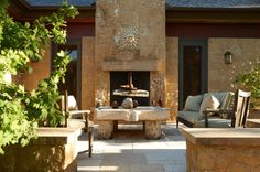 Gorgeous patio with stone fireplace  |  Interior designer Edward Lobrano