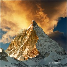 Golden peak - The Matterhorn (German), Cervino (Italian) or Cervin (French), is a mountain in the Pennine Alps. With its 4,478 metres (14,692 ft) high summit, lying on the border between Switzerland and Italy, it is one of the highest peaks in the Alps and its 1,200 metres (3,937 ft) north face is one of the Great north faces of the Alps.