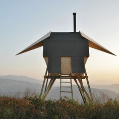 Milan studio AtelierFORTE have built a sauna in the northern Italian countryside that has wings like a bird