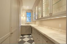 butlers pantry. grey and white marble floor.