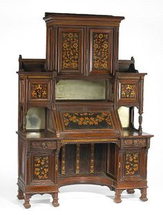 A fine American Aesthetic carved and inlaid rosewood secretary cabinet commissioned for the Salon of the Mark Hopkins Nob Hill residence, San Francisco, California executed by Herter Brothers, New York circa 1878