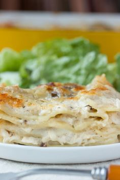 Chicken and mushroom lasagna has been a cold weather favorite in our house for a number of years. Its hearty layers of cheesy goodness always warm me up on cold, rainy Southern nights, and it's one of the few leftovers that I actually look forward to more than the main event.