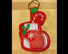 Home of quality, affordable Machine embroidery designs for the home embroidery enthusiast Backpack Tags, Christmas Stockings, Christmas Ornaments, Machine Embroidery Patterns, Key Fobs, 3d Design, As You Like, Hoop, Key Chains
