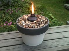 15 Backyard Tiki Torches To Light Up Your Yard - Table Tiki Torch Spray Paint+Terra Cotta Pot+River Pebbles+Tiki Torch Canister= Cheap & Pretty Table Torch Source by beverly_herndon - Backyard Projects, Outdoor Projects, Backyard Patio, Backyard Landscaping, Landscaping Ideas, Diy Patio, Backyard Camping, Outdoor Camping, Outdoor Pool