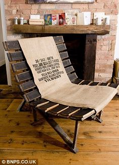 wine barrel chair; austerity home: Couple completely make over their house with reclaimed goods that cost them next to nothing    Read more: http://www.dailymail.co.uk/news/article-2079784/The-austerity-house-Couple-completely-make-home-reclaimed-goods.html#ixzz1pCnbQTZg