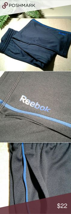 Reebok navy sweatpants Navy blue Reebok sweatpants with two side pockets and a blue verticle pinstripes. Wear them loose or use the convenient draw string to adjust the fit. Great condition! Reebok Pants Track Pants & Joggers