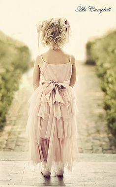 Such a cute flower girl dress! Still hoping my older sister will help me out with having a flower girl at the wedding :-)