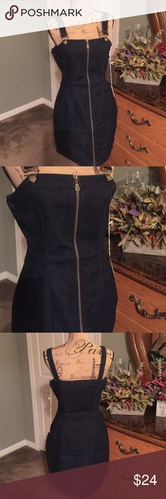Dress 😍😍😍so cute denim midi with zipper in front. Very cute and sexy on😀💕I just wish they had a xl. Just a little tight for my liking. Has very go stretch. 77.8 % cotton, 17.4% polyamide,3.3% viscous and 1.5 % spandex. NWT Mindcode Dresses Midi
