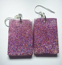 Glitter by day, Glow at night. Pink Glitter in glow in the dark resin. Rectangle shape on Sterling Silver earring hooks. Requires direct light in order to glow. Jewelry Design, Unique Jewelry, Handmade Items, Handmade Gifts, Pink Glitter, The Darkest, My Etsy Shop, Glow, Tote Bag
