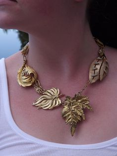 """Repurposed Vintage Jewelry Necklace, titled, """"GATHERED LEAVES"""", created with repurposed vintage leaf brooches. $75.00, via Etsy."""