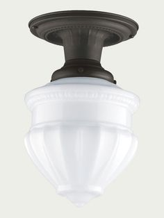 This reproduction light is a style that was popular in kitchens from 1921 until after World War II because it mixed Colonial-era styling, like scallop and bead details, with a stamped-brass body, which kept the price affordable. $109; Rejuvenation
