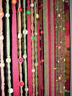 Mooi, maar dan blauwtonen en zandkleuren, zowel parels als touw...