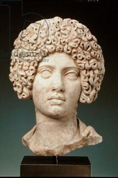 This is a sculptural portrait of a woman during the Imperial Roman Period, Trajanic or Hadrianic, 100-125 AD