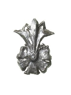 Pilgrim badge, probably from the shrine of Our Lady of Walsingham at Walsingham Priory in Norfolk. This badge is in the form of a rose with a lily sprouting from its centre. Both the rose and the lily were symbols of the Virgin Mary (the rose was a sign of her love and the lily was a sign of her purity). Production Date: Late Medieval; 15th century